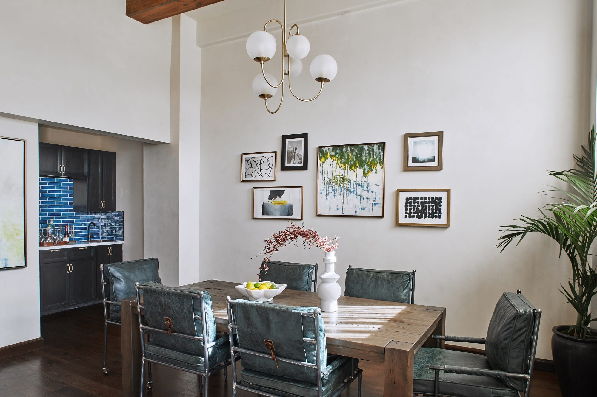 dining room with high ceiling, table with chairs and bar sink