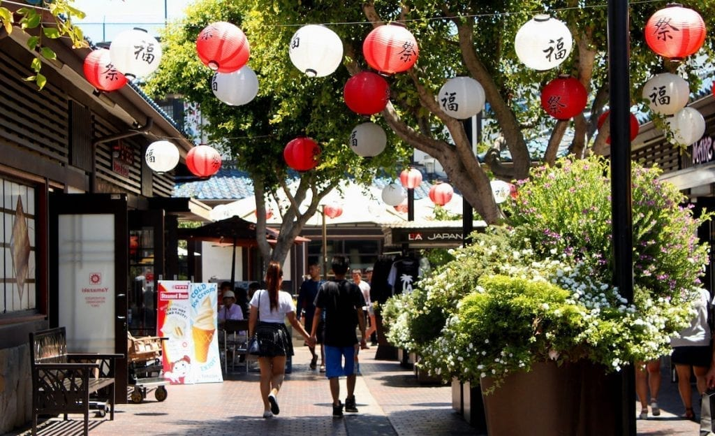 outdoor area in little Tokyo with lanterns and bushes