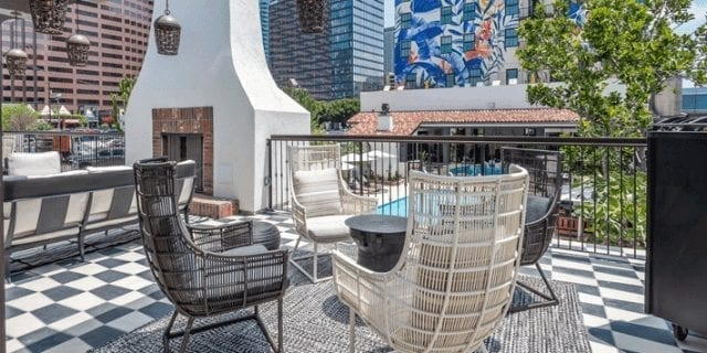 outdoor patio furniture, tiled floor and fireplace